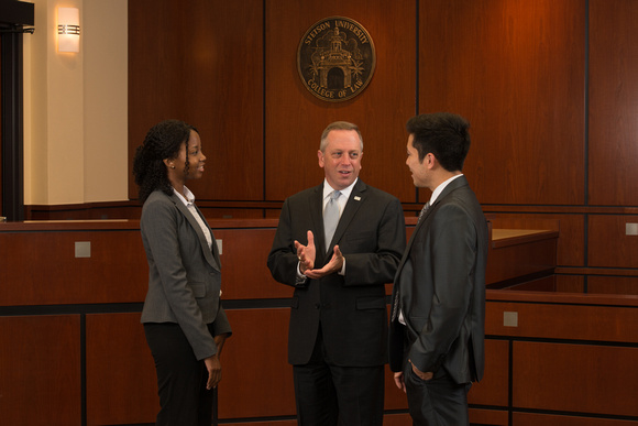 Dean and Professor Christopher Pietruszkiewicz speaks with students in the Eleazer Courtroom.