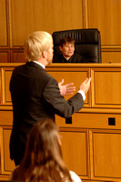 Professor Ellen Podgor plays the role of judge in a courtroom scenario.
